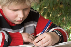 Teenager boy writing his exercise. Teenager boy writing his homework exercise Royalty Free Stock Photography