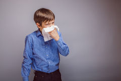 Teenager boy of 10 years European appearance sick Stock Photography