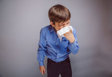 Teenager boy 10 years of European appearance sick Royalty Free Stock Photo