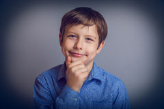 Teenager boy years of European appearance thinks Royalty Free Stock Photography