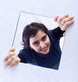 Teenager breaking out of the box Royalty Free Stock Image