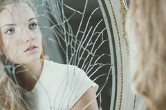 Teenager and broken mirror Royalty Free Stock Images