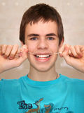 Teenager with dental floss Royalty Free Stock Photo