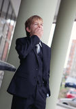 Teenager in business suit yawning Royalty Free Stock Photography