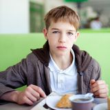 Teenager in cafe eating fast food. Indoor stock images