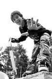 Teenager in Camouflage with Skateboard Royalty Free Stock Images