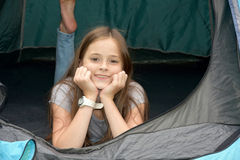 Teenager at camping vacations. Teenage girl at camping relaxing in a tent Stock Photos