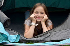 Teenager at camping vacations. Teenage girl at camping relaxing in a tent Royalty Free Stock Image