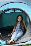 Teenager at camping vacations. Teenage girl at camping relaxing in a tent Royalty Free Stock Photo