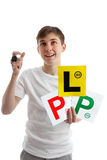 Teenager with car licence plates looking up royalty free stock photography