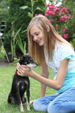 Teenager caressing her miniature pinscher Stock Photo