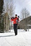 Teenager carrying ski gear. Stock Photo