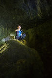 Teenager in a cave Royalty Free Stock Photo