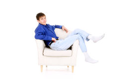 Teenager in chair Royalty Free Stock Image
