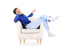 Teenager in chair Royalty Free Stock Images