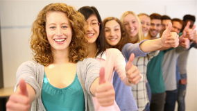 Teenager cheering with thumbs up stock footage