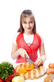 Teenager chef cook cuts carrots Royalty Free Stock Photography