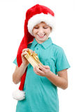 Teenager and christmas gift Stock Images
