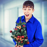 Teenager with Christmas Tree royalty free stock image