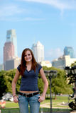 Teenager in city. Half body portrait of smiling teenager with Philadelphia city skyscrapers in background, Pennsylvania, U.S.A Stock Photos