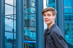 Teenager for in city going for first job smiling Royalty Free Stock Image