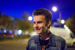 Teenager and city lights Royalty Free Stock Photography