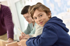 Teenager in class with teachers. Portrait of 10-year-old school boy in class Royalty Free Stock Photography