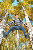 Teenager climb a tree Royalty Free Stock Photography