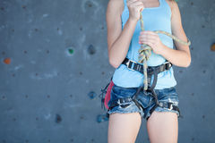 Teenager climbing a rock wall Stock Photography