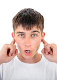 Teenager with Closed Ears Royalty Free Stock Images