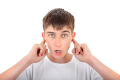 Teenager with Closed Ears Royalty Free Stock Image