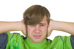 Teenager closes ears. On a white background Royalty Free Stock Photo
