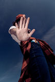The teenager closes a hand over his face. Royalty Free Stock Photography