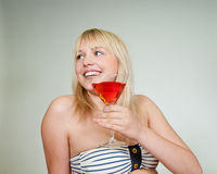Teenager with cocktail. Happy young blond woman with red cocktail stock photos