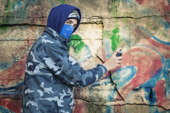 Teenager with color spray can Stock Photography