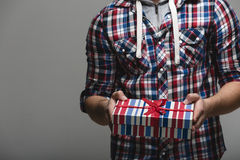Teen in plaid with gift box Royalty Free Stock Photography