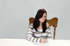 Teenager completing form Stock Photos