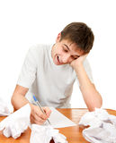 Teenager compose a Letter. Cheerful Young Man compose a Letter on the White Background royalty free stock photo