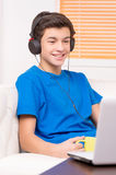 Teenager at the computer. Royalty Free Stock Photos