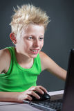 Teenager at a computer Royalty Free Stock Photography