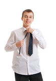 The teenager corrects a tie Stock Photography