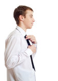 The teenager corrects a tie Royalty Free Stock Image