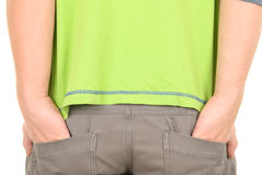 Teenager costs having thrust hands in pockets. On white background Royalty Free Stock Images