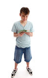Teenager counting his money. A boy counting or sorting his money cash. White background royalty free stock images