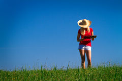 Teenager in countryside Stock Image