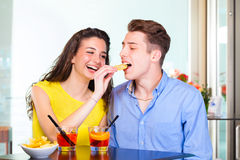 Teenager couple with cocktail and chips Stock Photography