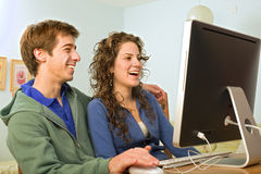 Teenager couple computer. Teenager couple and imac computer Royalty Free Stock Images