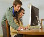 Teenager couple computer. Teenager couple and imac computer Stock Photos
