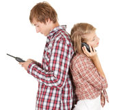 Teenager couple with mobile phones Stock Images
