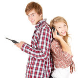 Teenager couple with mobile phons Royalty Free Stock Photography